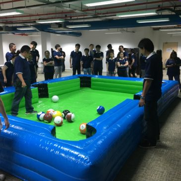 people playing inflatable snooker