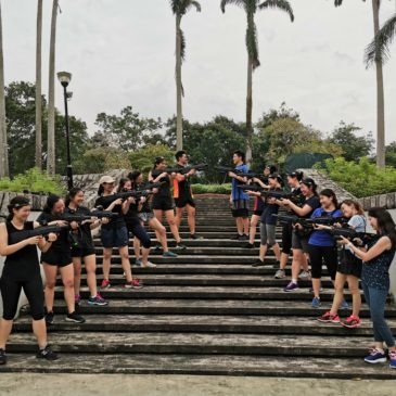a group of people playing laser tag for team building in singapore