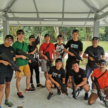 a group of people holding onto laser tag equipment in Singapore